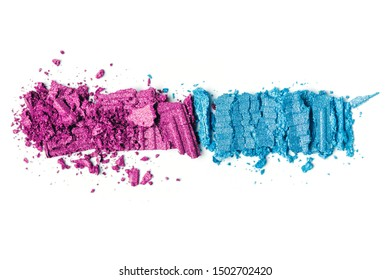 A broken pink and blue eye shadow smear make up palette isolated on a white background. Top view, flat lay. Copy space for your text