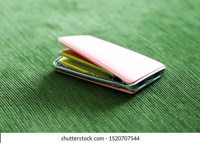 Broken pink bower bank closeup on green texture fabric background