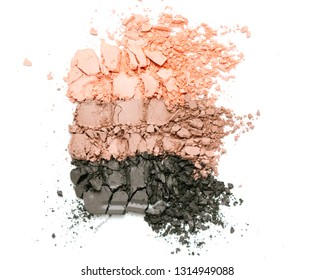 A broken pink gradient colored eye shadows isolated on a white background. Top view, flat lay. Copy space for your text
