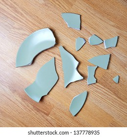 Broken plate on the floor