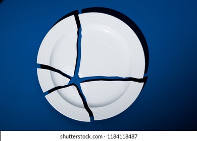 broken porcelain plate on a blue background