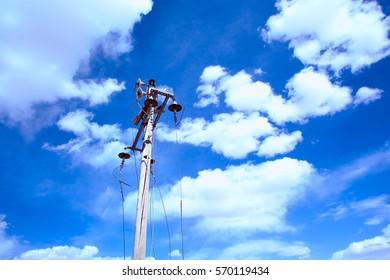 Broken Power pole and blue sky