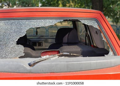 Broken rear car glass burglary damage