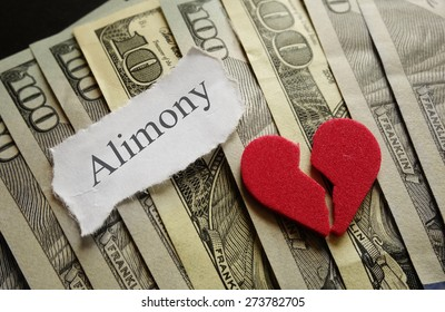 Broken red heart and Alimony paper note on cash