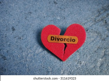 Broken red heart with a bandaid and Divorcio (Divorce) text