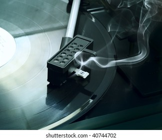 Broken retro vinyl player with smoke