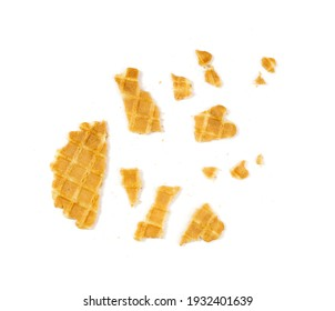 Broken round waffle isolated. Crumbled thin waffled cookie, golden belgian waffles bites, wafer crumbles on white background