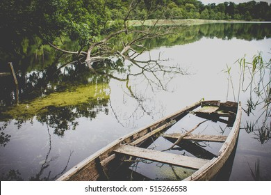 Broken Row Boat in a Lake. With a processing Filter giving a Cinematic, Movie Like  Look