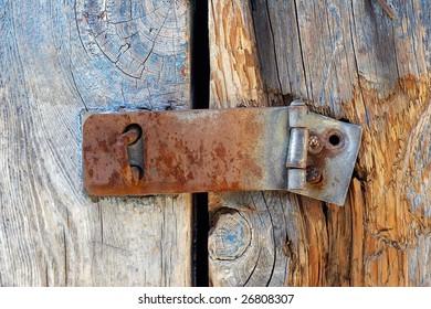broken, rusted iron barn lock