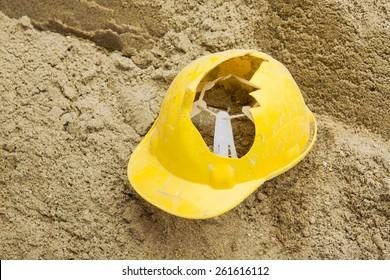 broken safety helmet on the sand