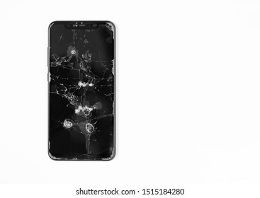 Broken screen cell phone on white isolated background. Close-up.