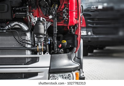 Broken Semi Truck Service Closeup Photo. Truck Maintenance Before Long Heavy Load Trip.