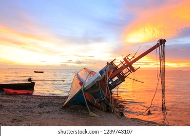 The broken ship with the sea and sunset twilight sky