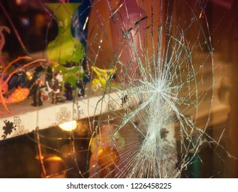 Broken shop window with color background