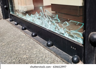 Broken showcase glass. Robbery, security, protection and insurance concept.