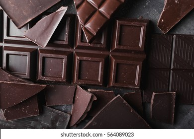 Broken slices of chocolate close up
