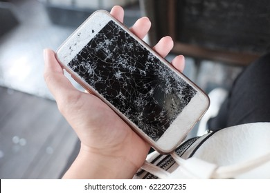 The broken of smart mobile phone showing the mirror or touch screen cracked (shallow depth of field)