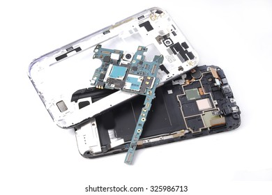 Broken smart phone , mobile phone parts on white background