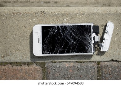 Broken smartphone with smashed dipsplay screen