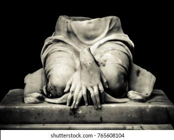 A broken statue of a gravestone