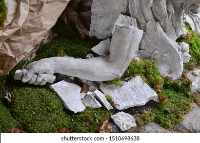 Broken stone statue detail of human hand