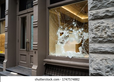 Broken store window by vandals