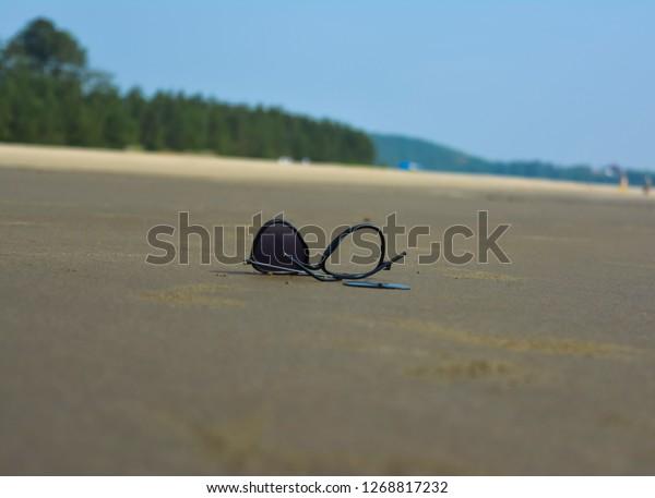 Broken sun glass on the beach
