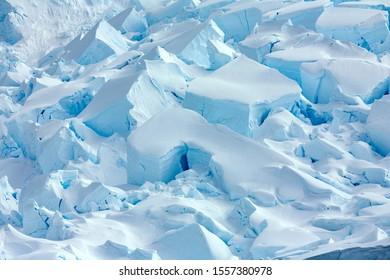 The broken surface and crevasses of Neko Harbor Glacier at Andvord Bay on the Antarctic Peninsula in Antarctica.