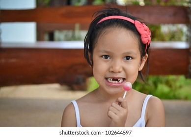 broken teeth girl and lollypop of thailand southeast asia
