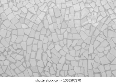 Broken tiles mosaic seamless pattern. White and Gray tile real wall high resolution real photo or brick seamless with texture interior background. Abstract wallpaper irregular in bathroom.