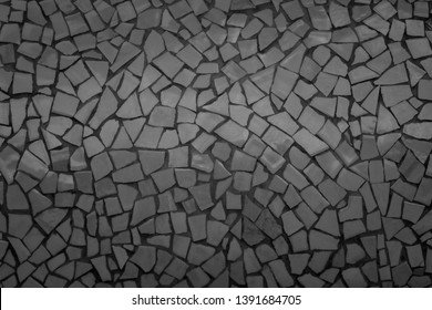 Broken tiles mosaic seamless pattern. Black Dark tile real wall high resolution real photo or brick seamless with texture interior background. Abstract wallpaper irregular in bathroom.
