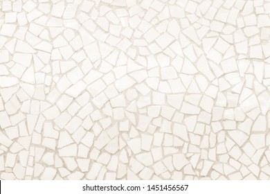 Broken tiles mosaic seamless pattern. Cream tile real wall high resolution real photo or brick seamless with texture interior background. Abstract wallpaper irregular in bathroom.