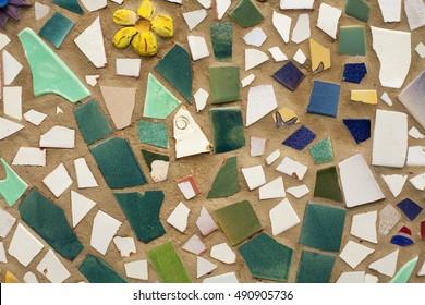 Broken tiles on a wall
