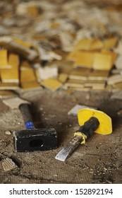 Broken tiles and tools