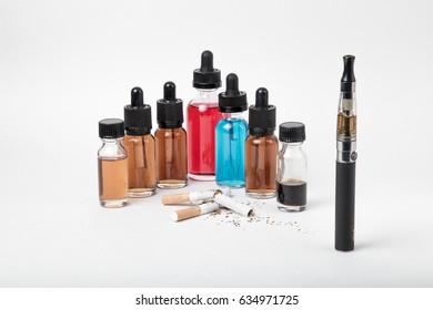 Broken tobacco cigarettes with modern electronic cigarette