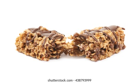 Broken in two parts chocolate nutrient chewy grains bar isolated over the white background