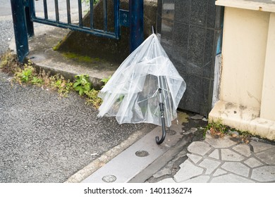 Broken umbrella left on the street