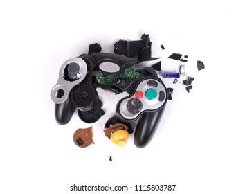 Broken video game controller on white background with clipping path