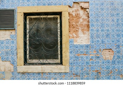 Broken vintage blue Portuguese azulejo tiles in Tomar, Portugal.