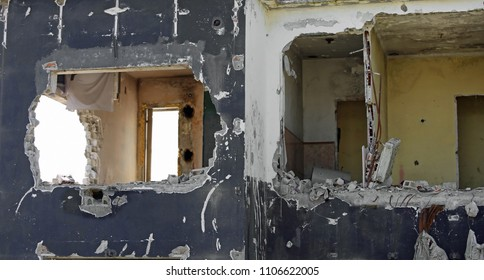 broken walls of a destroyed house