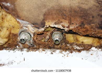 Broken water pipe. Moldy wood and wool behind the tiles.
