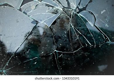 broken wet glass dark background