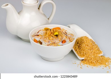 Broken wheat cereal cooked in Milk or dalia from indian cuisine served in a bowl