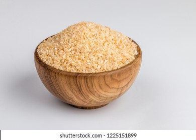 Broken wheat cereal Food Also Know as Bulgur, Dalia or Daliya in Woden bowl