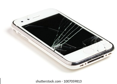 Broken white mobile phone / cell phone / smartphone isolated on white background.
