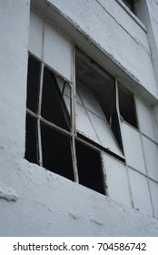 Broken White Painted Glass Window in Abandoned Old White Warehouse