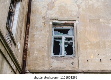 The broken window of the abandoned barrack.