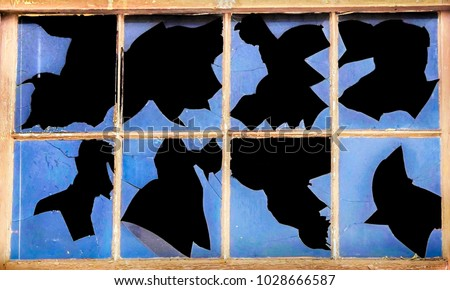 A broken window from an abandoned building at the old Fort Ord military barracks in Marina, California, makes unusual patterns, resembling a Rorschach Test.