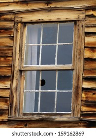 Broken window in abandoned stagecoach station in Colorado