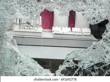 Broken window after jewelry robbery.